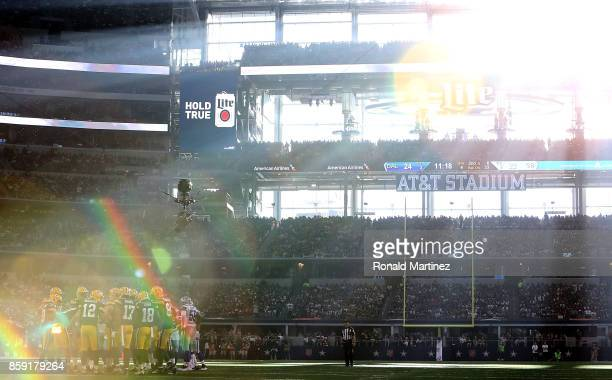 Aaron Rodgers of the Green Bay Packers huddles with his team at ATT Stadium on October 8 2017 in Arlington Texas