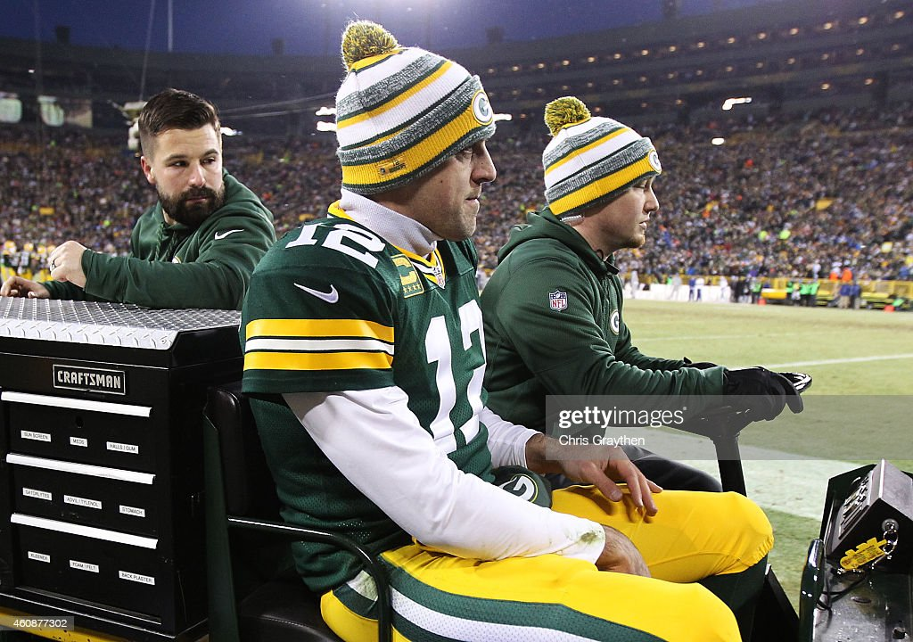 Aaron Rodgers #12 of the Green Bay Packers is carted off of the field with an injury in the second quarter against the Detroit Lions at Lambeau Field on December 28, 2014 in Green Bay, Wisconsin.