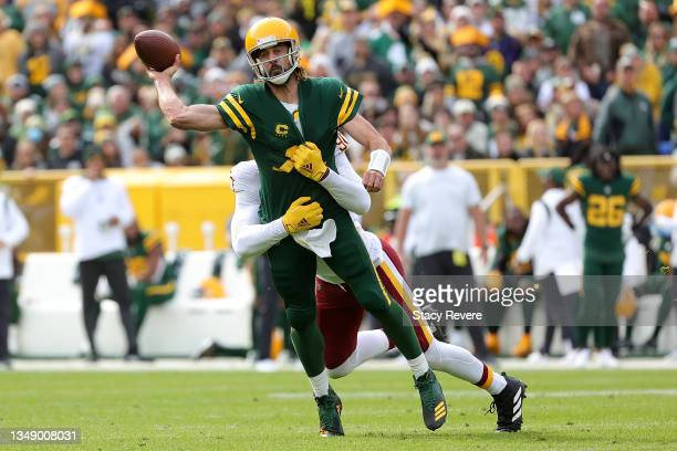 Aaron Rodgers of the Green Bay Packers is pressured by Montez Sweat of the Washington Football Team during a game at Lambeau Field on October 24,...