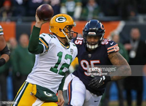 Aaron Rodgers of the Green Bay Packers is pursued by Roy RobertsonHarris of the Chicago Bears at Soldier Field on December 16 2018 in Chicago...