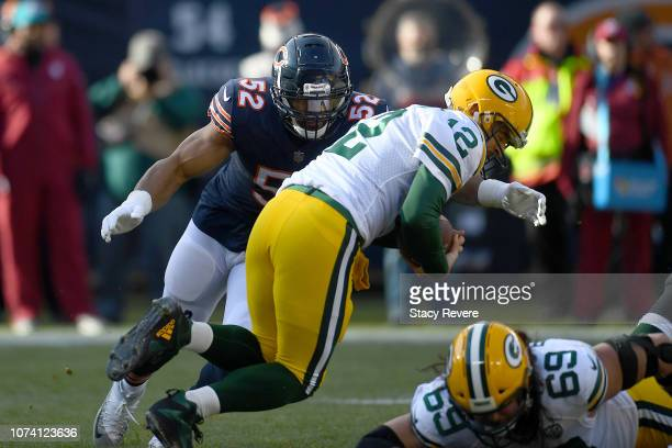 Aaron Rodgers of the Green Bay Packers is sacked by Khalil Mack of the Chicago Bears in the first quarter at Soldier Field on December 16 2018 in...