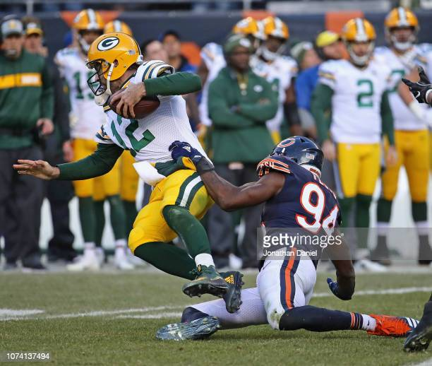 Aaron Rodgers of the Green Bay Packers is sacked by Leonard Floyd of the Chicago Bears at Soldier Field on December 16 2018 in Chicago IllinoisThe...