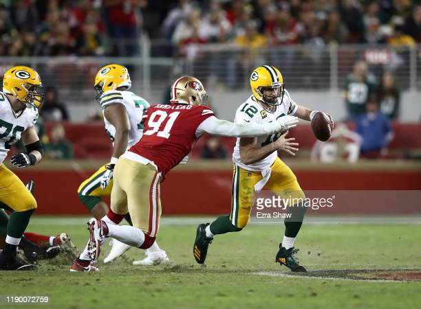 Aaron Rodgers of the Green Bay Packers is tackled by Arik Armstead of the San Francisco 49ers at Levi's Stadium on November 24 2019 in Santa Clara...