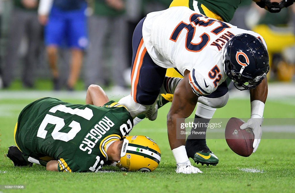 Aaron Rodgers #12 of the Green Bay Packers lays on the ground after injuring his leg in the second quarter of a game against the Chicago Bears at Lambeau Field on September 9, 2018 in Green Bay, Wisconsin.