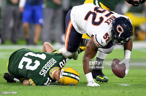 Aaron Rodgers of the Green Bay Packers lays on the ground after injuring his leg in the second quarter of a game against the Chicago Bears at Lambeau...
