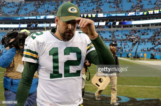 Aaron Rodgers of the Green Bay Packers leaves the field after a 31-24 loss to the Carolina Panthers at Bank of America Stadium on December 17, 2017...