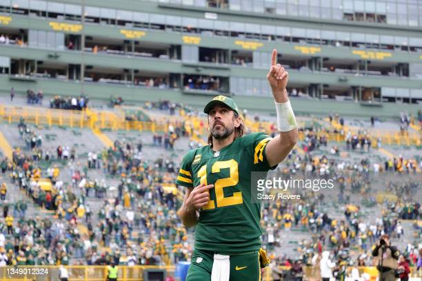 Aaron Rodgers of the Green Bay Packers leaves the field following a game against the Washington Football Team at Lambeau Field on October 24, 2021 in...