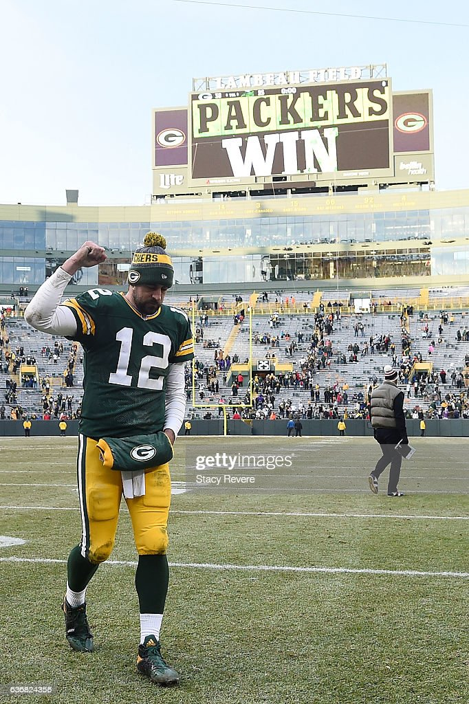 Aaron Rodgers #12 of the Green Bay Packers leaves the field following a game against the Minnesota Vikings at Lambeau Field on December 24, 2016 in Green Bay, Wisconsin. The Packers defeated the Vikings 38-25.