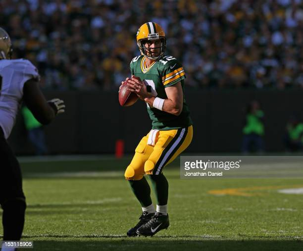 Aaron Rodgers of the Green Bay Packers looks for a receiver against the New Orleans Saints at Lambeau Field on September 30 2012 in Green Bay...