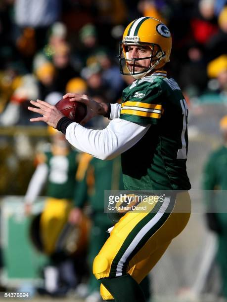 Aaron Rodgers of the Green Bay Packers looks for a receiver against the Detroit Lions on December 28 2008 at Lambeau Field in Green Bay Wisconsin The...