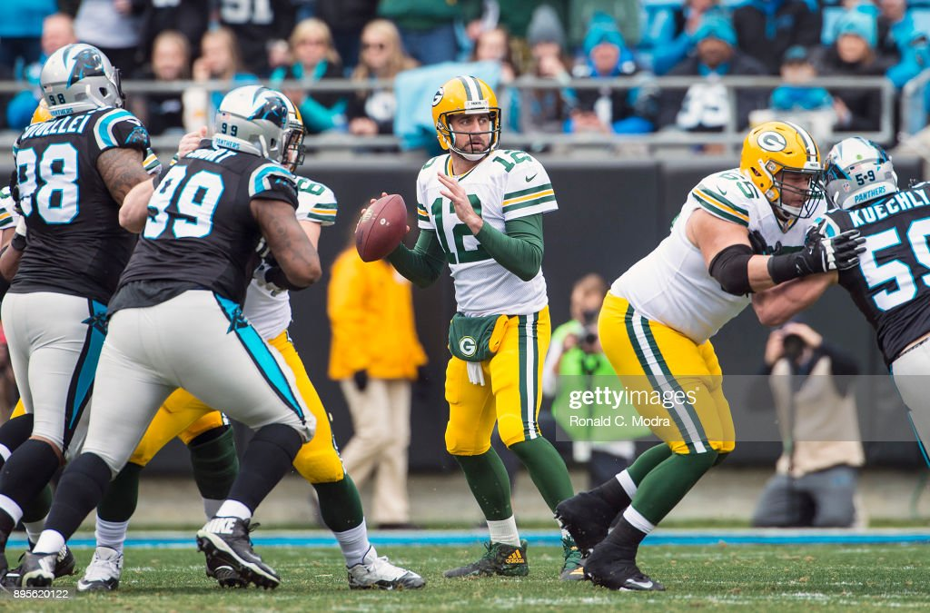 Aaron Rodgers #12 of the Green Bay Packers looks for a receiver against the Carolina Panthers during a NFL game at Bank of America Stadium on December 17, 2017 in Charlotte, North Carolina.