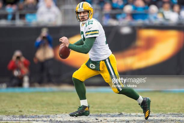 Aaron Rodgers of the Green Bay Packers looks for a receiver against the Carolina Panthers during a NFL game at Bank of America Stadium on December 17...