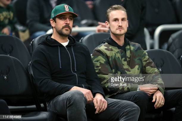 Aaron Rodgers of the Green Bay Packers looks on before the game between the Oklahoma City Thunder and Milwaukee Bucks at the Fiserv Forum on April 10...