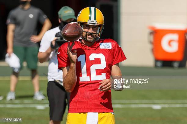 Aaron Rodgers of the Green Bay Packers looks on during Green Bay Packers Training Camp at Ray Nitschke Field on August 19, 2020 in Ashwaubenon,...