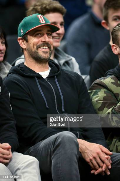 Aaron Rodgers of the Green Bay Packers looks on during the game between the Oklahoma City Thunder and Milwaukee Bucks at the Fiserv Forum on April 10...