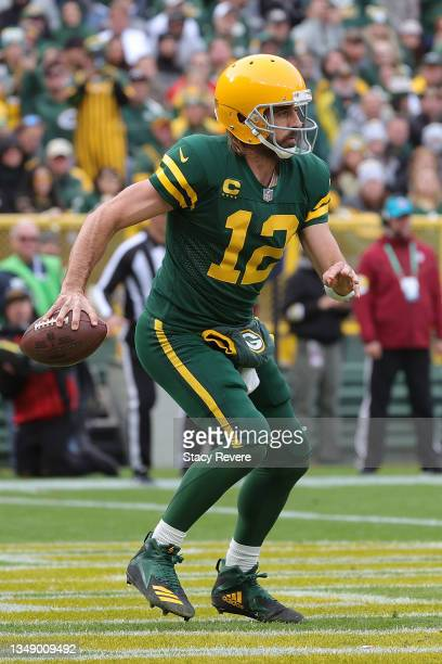 Aaron Rodgers of the Green Bay Packers looks to pass during a game against the Washington Football Team at Lambeau Field on October 24, 2021 in Green...