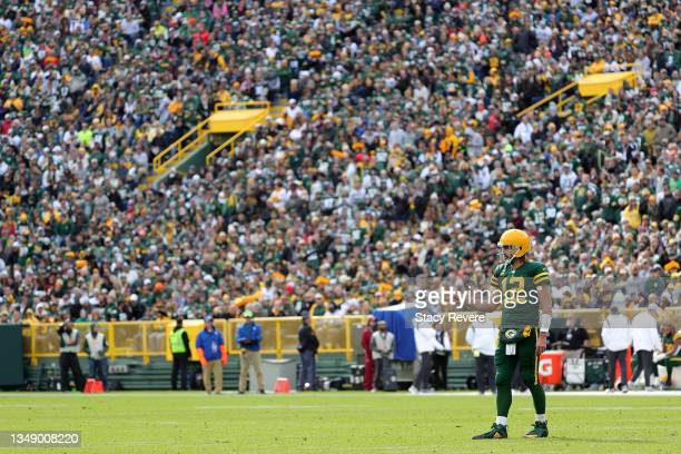 Aaron Rodgers of the Green Bay Packers looks to the Washington Football Team sideline during a game at Lambeau Field on October 24, 2021 in Green...