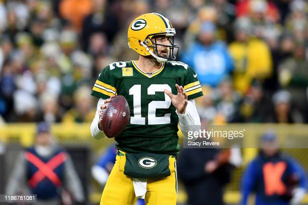 Aaron Rodgers of the Green Bay Packers looks to throw a pass against the Carolina Panthers during the first quarter in the game at Lambeau Field on...