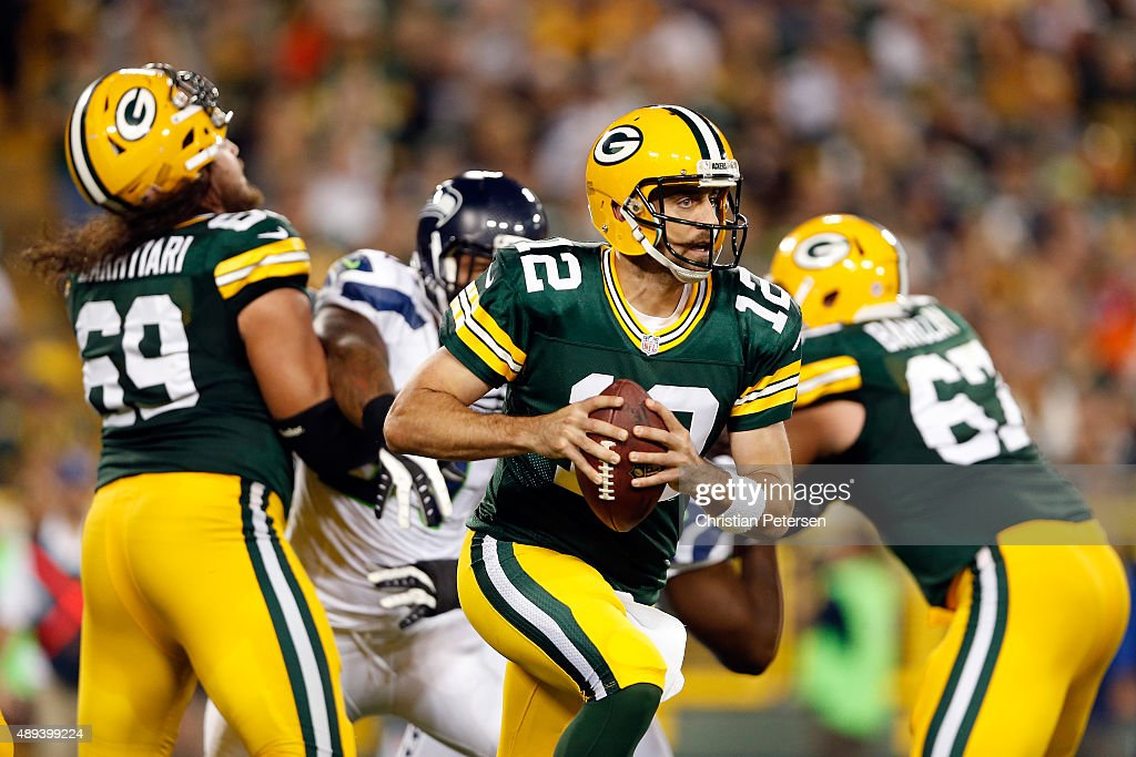 Aaron Rodgers #12 of the Green Bay Packers looks to throw a pass in the second quarter against the Seattle Seahawks during their game at Lambeau Field on September 20, 2015 in Green Bay, Wisconsin.