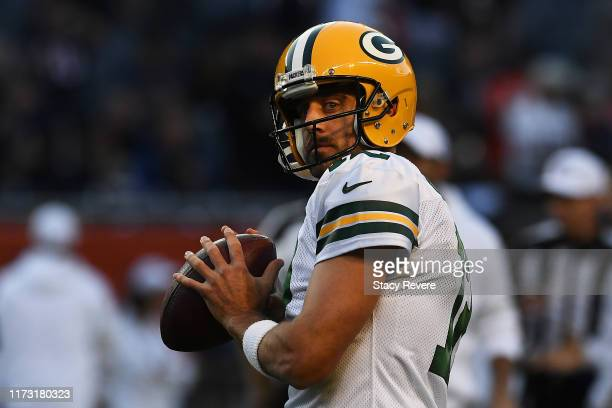 Aaron Rodgers of the Green Bay Packers participates in warmups prior to a game against the Chicago Bears at Soldier Field on September 05 2019 in...