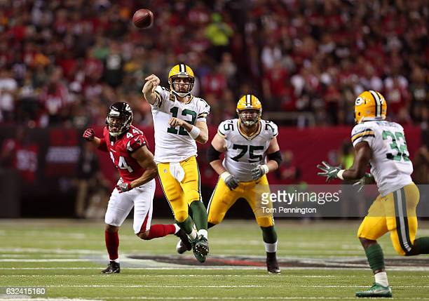 Aaron Rodgers of the Green Bay Packers passes in the third quarter against Vic Beasley of the Atlanta Falcons in the NFC Championship Game at the...