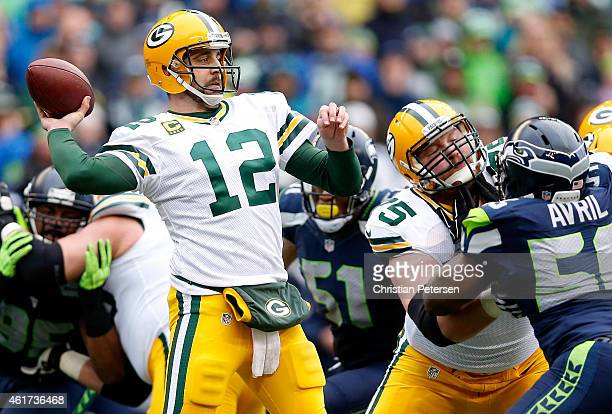Aaron Rodgers of the Green Bay Packers passes the ball during the first half of the 2015 NFC Championship game against the Seattle Seahawks at...