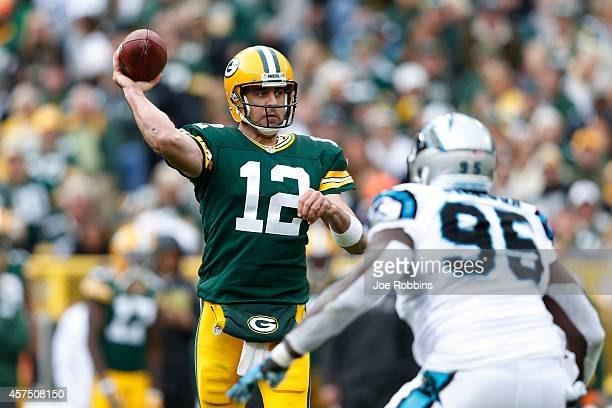 Aaron Rodgers of the Green Bay Packers passes the ball in the second half of the game against the Carolina Panthers at Lambeau Field on October 19...