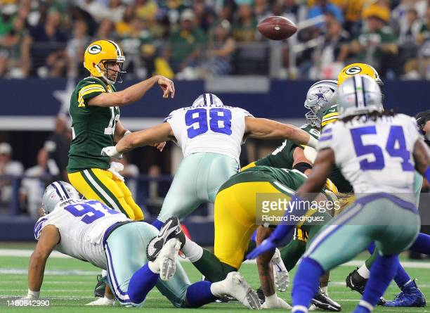 Aaron Rodgers of the Green Bay Packers passes under pressure from Tyrone Crawford of the Dallas Cowboys at AT&T Stadium on October 06, 2019 in...