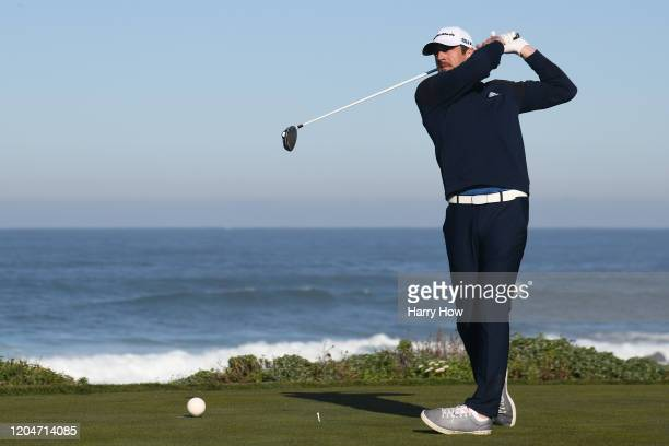 Aaron Rodgers of the Green Bay Packers plays his shot from the 13th tee during the second round of the ATT Pebble Beach ProAm at Monterey Peninsula...