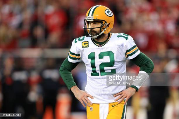 Aaron Rodgers of the Green Bay Packers reacts after a fumble in the first half against the San Francisco 49ers during the NFC Championship game at...