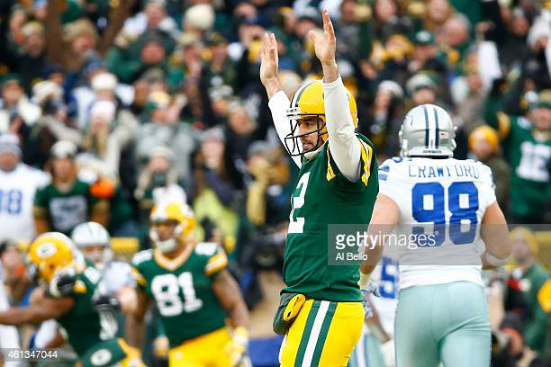 Aaron Rodgers of the Green Bay Packers reacts after completing a pass against the Dallas Cowboys during the 2015 NFC Divisional Playoff game at...