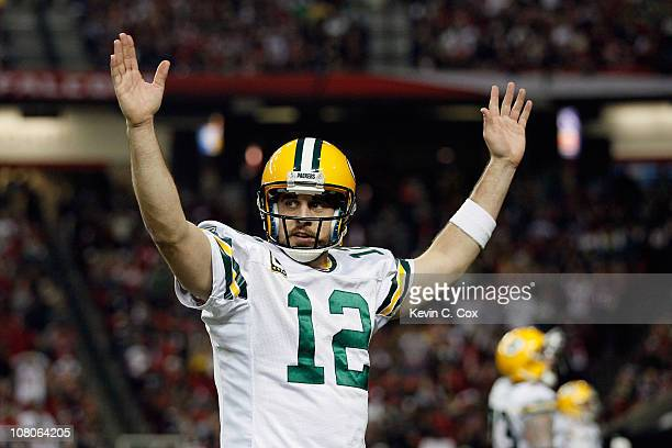 Aaron Rodgers of the Green Bay Packers reacts after he threw a 7yard touchdown to John Kuhn in the third quarter against the Atlanta Falcons during...