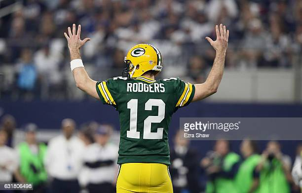Aaron Rodgers of the Green Bay Packers reacts after the Packers scored a touchdown against the Dallas Cowboys during the NFC Divisional Playoff Game...