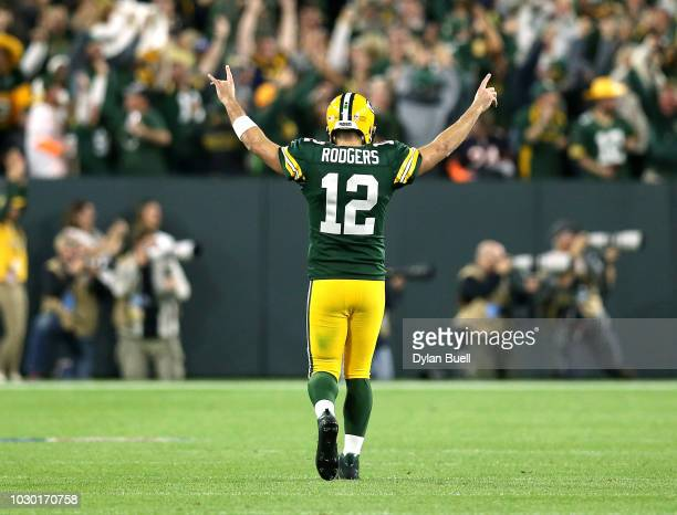 Aaron Rodgers of the Green Bay Packers reacts after throwing a touchdown pass to Randall Cobb during the fourth quarter of a game against the Chicago...
