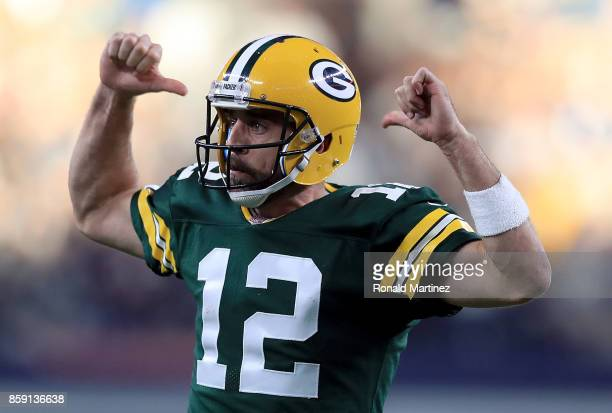 Aaron Rodgers of the Green Bay Packers reacts after throwing the game winning touchdown against the Dallas Cowboys in the fourth quarter at ATT...