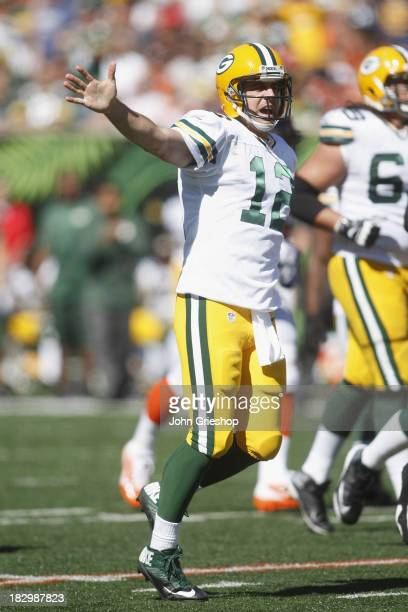 Aaron Rodgers of the Green Bay Packers runs upfield during the game against the Cincinnati Bengals at Paul Brown Stadium on September 22 2013 in...