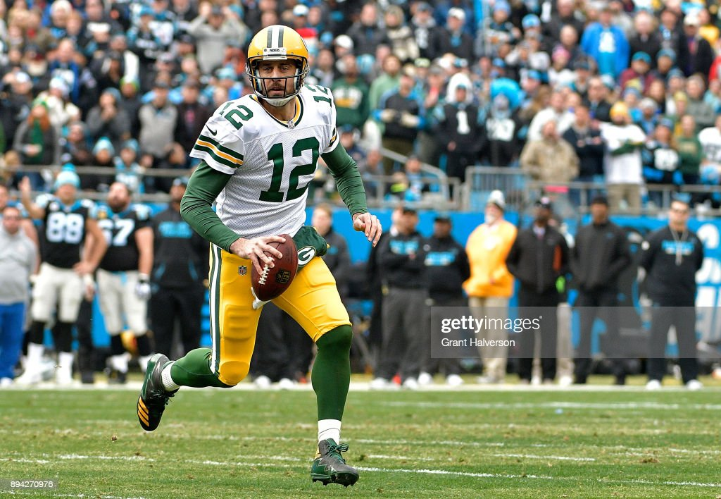 Aaron Rodgers #12 of the Green Bay Packers runs with the ball against the Carolina Panthers in the second quarter during their game at Bank of America Stadium on December 17, 2017 in Charlotte, North Carolina.