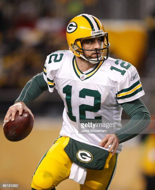 Aaron Rodgers of the Green Bay Packers scrambles away from the defense of the Pittsburgh Steelers during the game on December 20 2009 at Heinz Field...