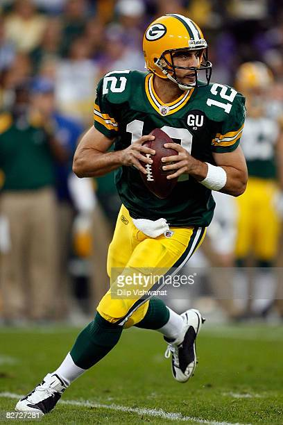 Aaron Rodgers of the Green Bay Packers scrambles in the second quarter while taking on the Minnesota Vikings on September 8, 2008 at Lambeau Field in...