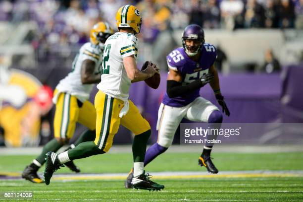 Aaron Rodgers of the Green Bay Packers scrambles with the ball Anthony Barr of the Minnesota Vikings during the game on October 15 2017 at US Bank...