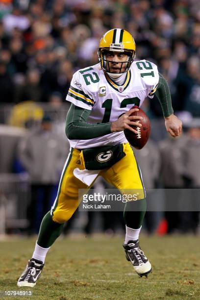 Aaron Rodgers of the Green Bay Packers scrambles with the ball against the Philadelphia Eagles during the 2011 NFC wild card playoff game at Lincoln...