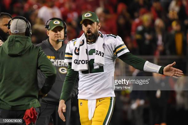 Aaron Rodgers of the Green Bay Packers speaks with head coach Matt LaFleur during the second half of the NFC Championship game against the San...