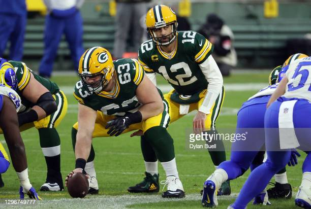 Aaron Rodgers of the Green Bay Packers stands under center in the first half against the Los Angeles Rams during the NFC Divisional Playoff game at...