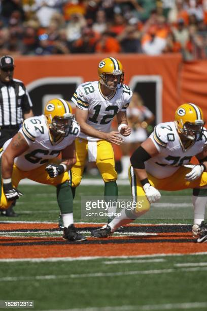 Aaron Rodgers of the Green Bay Packers takes the snap during the game against the Cincinnati Bengals at Paul Brown Stadium on September 22 2013 in...