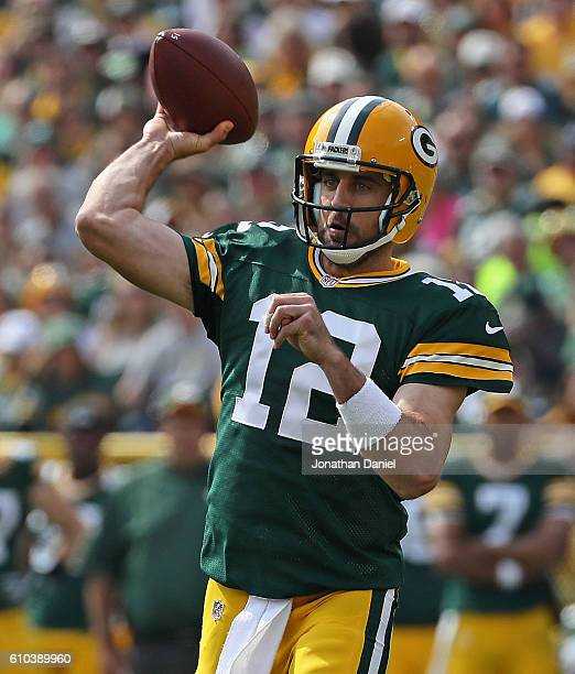 Aaron Rodgers of the Green Bay Packers throws a first quarter touchdown pass against the Detroit Lions at Lambeau Field on September 25 2016 in Green...