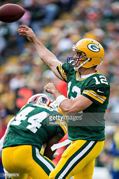 Aaron Rodgers of the Green Bay Packers throws a pass against the Washington Redskins at Lambeau Field on September 15 2013 in Green Bay Wisconsin The...
