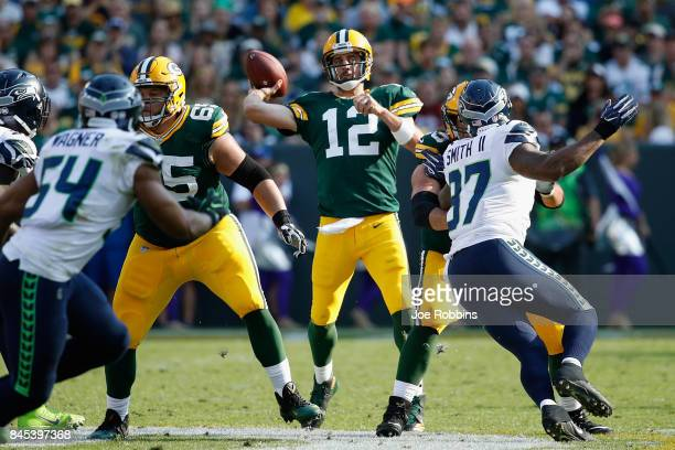 Aaron Rodgers of the Green Bay Packers throws a pass during the first half against the Seattle Seahawks at Lambeau Field on September 10 2017 in...