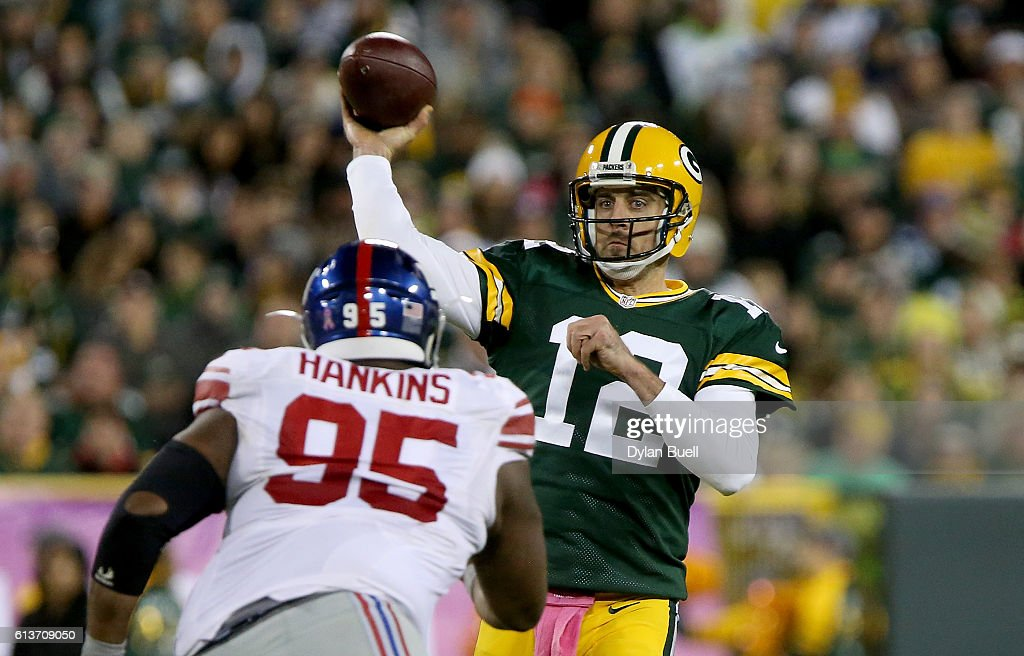 Aaron Rodgers #12 of the Green Bay Packers throws a pass in the third quarter against the New York Giants at Lambeau Field on October 9, 2016 in Green Bay, Wisconsin.