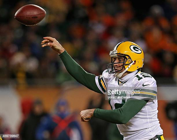 Aaron Rodgers of the Green Bay Packers throws a touchdown pass in the third quarter against the Chicago Bears at Soldier Field on December 29 2013 in...
