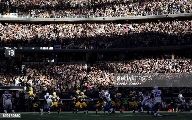 Aaron Rodgers of the Green Bay Packers throws against the Dallas Cowboys in the fourth quarter at ATT Stadium on October 8 2017 in Arlington Texas